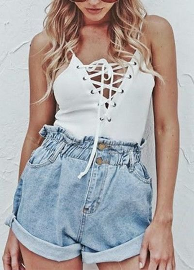 white spaghetti top with lacing and blue denim shorts with elastic waist