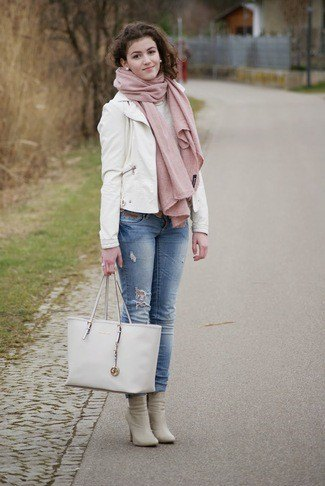 white leather blazer with blue jeans with cuffs and pink boots with heels