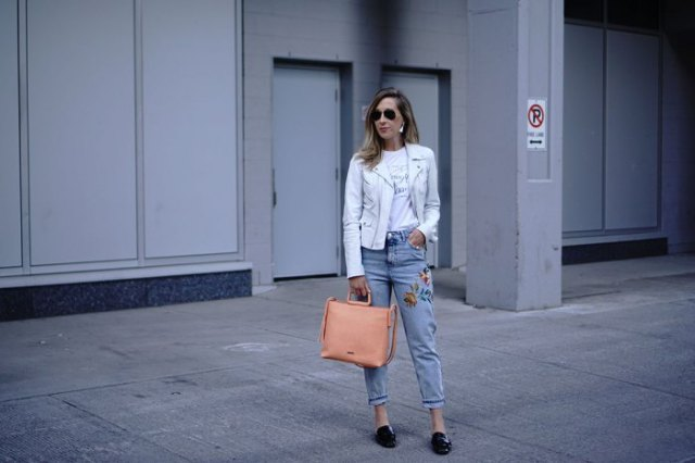 white leather jacket with blue embroidered mom jeans
