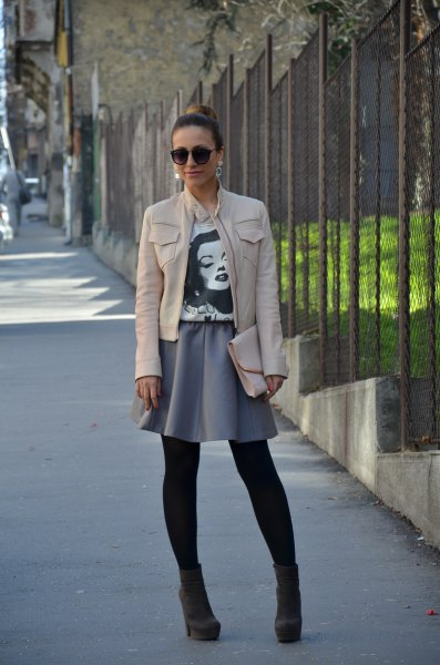white leather jacket with gray minirater skirt