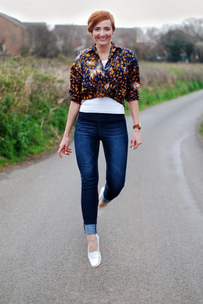 white moccasins, black floral knotted shirt