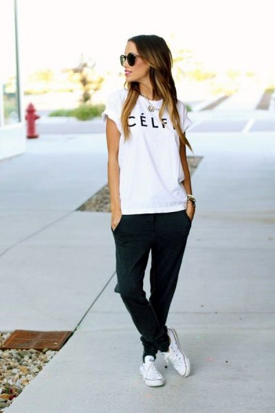 white logo t-shirt with black jogger jeans and sneakers