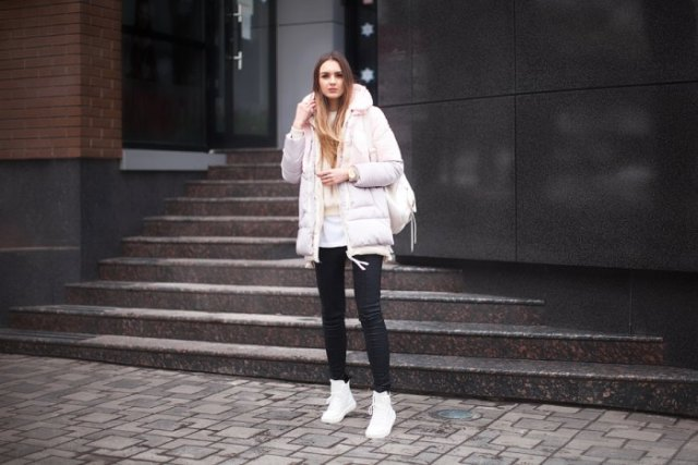 white long bubble coat with black skinny jeans and high sneakers