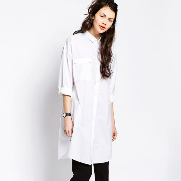 white long shirt with buttons and black slim fit jeans