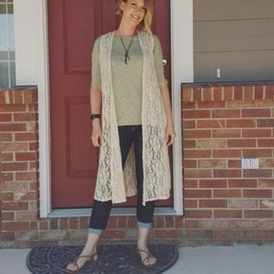 white long lace vest with half sleeves gray t-shirt dark blue jeans