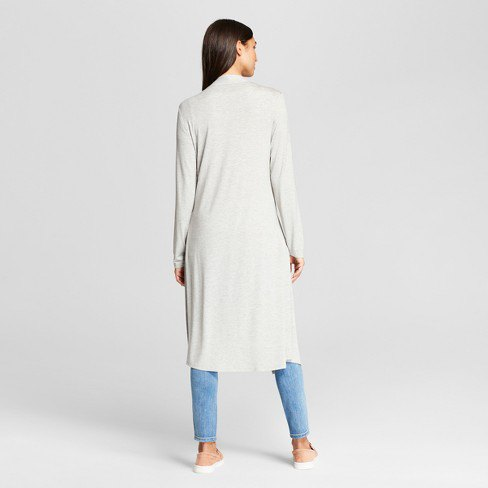 white long sweater with midi shawl collar and light blue jeans