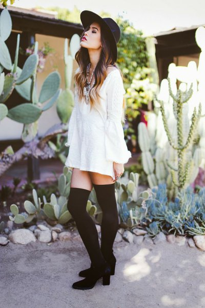 white long-sleeved blouse dress with tights and ankle boots