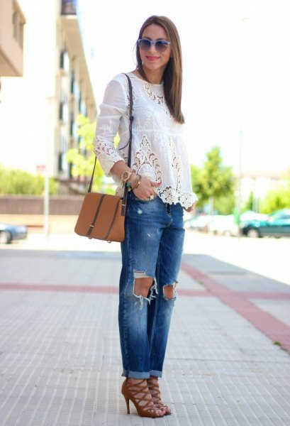 white long-sleeved blouse with ripped jeans and red strappy lace-up shoes