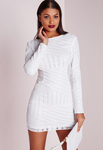 white, long-sleeved, figure-hugging mini dress with a subtle pattern