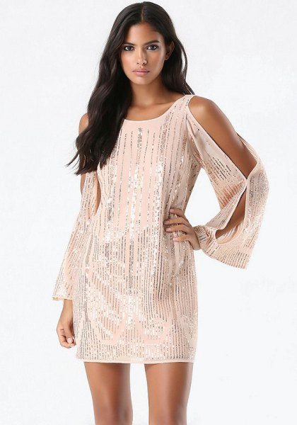 white long-sleeved cocktail dress made of sequins with cold shoulders