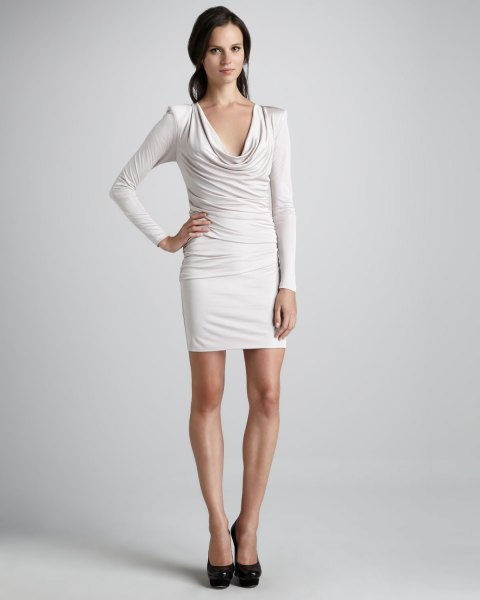 white, long-sleeved, figure-hugging dress with a cowl neckline