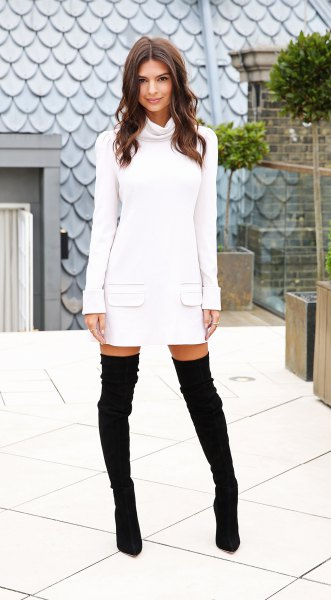 white long-sleeved sweater dress with waterfall neckline and over-the-knee suede boots