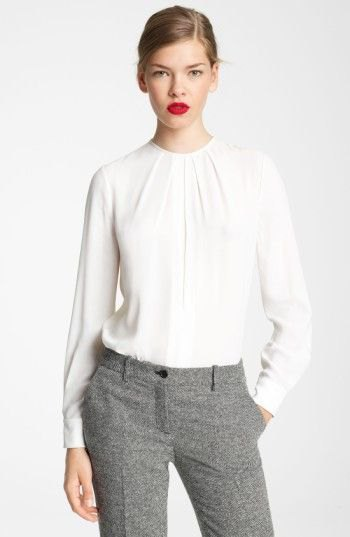 white long-sleeved blouse with round neckline and relaxed fit and tweed trousers