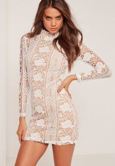 white long-sleeved crochet mini dress