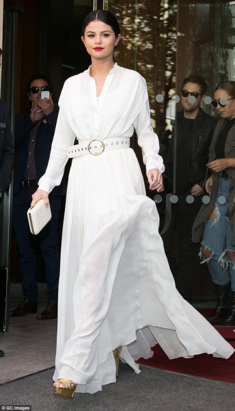 white floor-length flared long-sleeved dress with matching belt