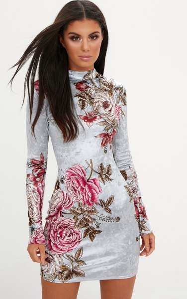 white, long-sleeved, figure-hugging dress made of floral velvet