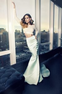 white, long-sleeved, figure-hugging crop top with a silver maxi mermaid skirt