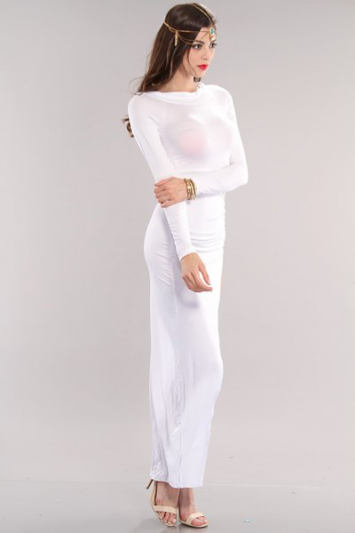 white, long-sleeved, figure-hugging maxi dress