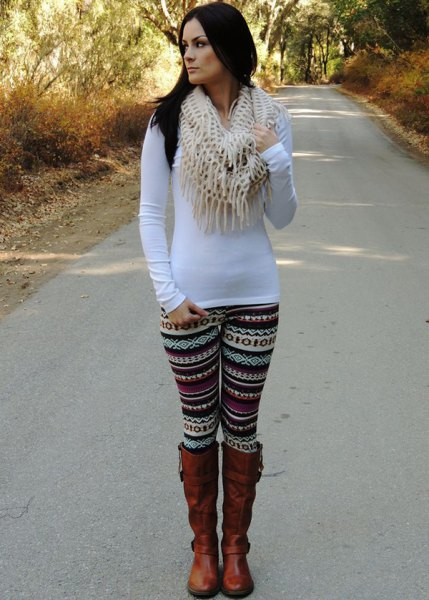 white, long-sleeved, figure-hugging t-shirt with leggings with tribal print and brown boots