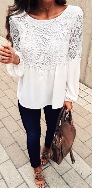 white long-sleeved lace blouse with black skinny jeans
