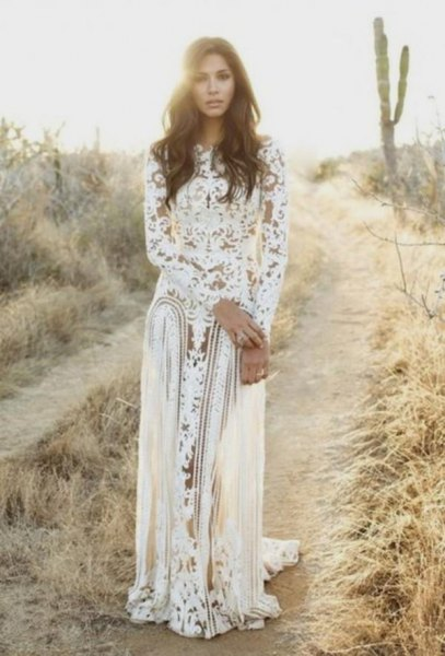 white, long-sleeved, flowing lace dress