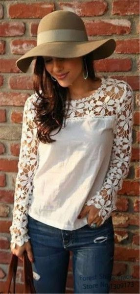 white long-sleeved linen blouse with lace details