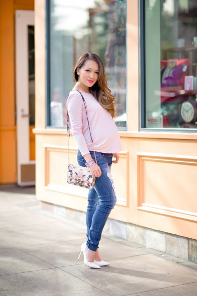white long-sleeved maternity t-shirt with blue, slim-fit jeans