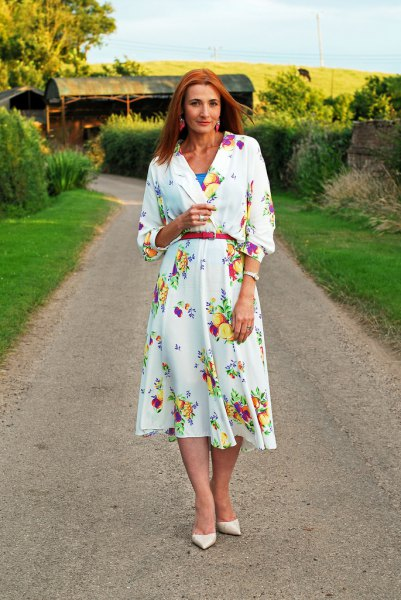 white long-sleeved midi dress with floral pattern and belt