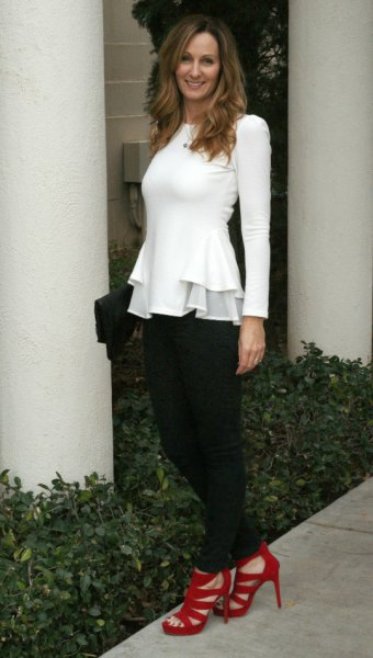 white long-sleeved peplum top with black chinos and red heels