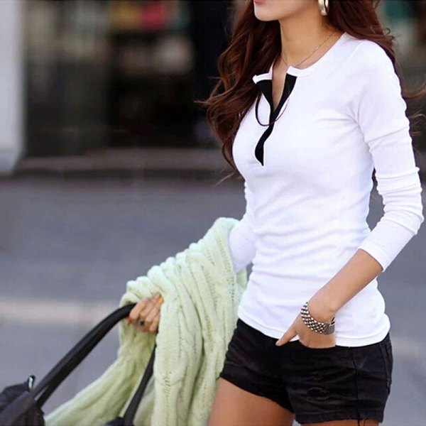 white long-sleeved shirt made of polo cotton with black mini shorts
