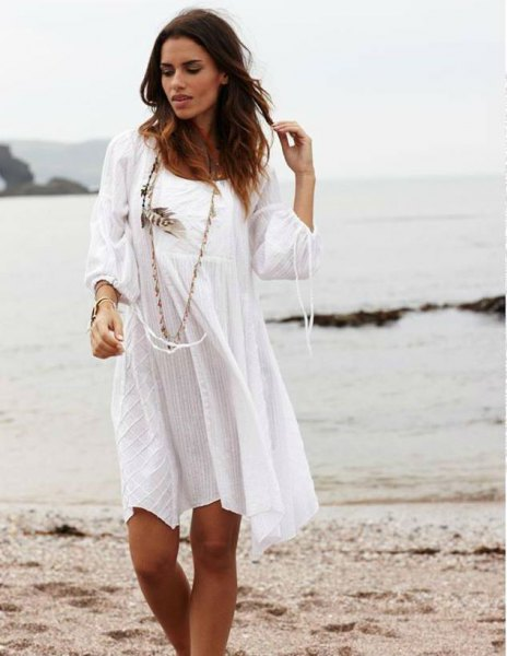 white long-sleeved mini dress made of cotton with scoop neckline