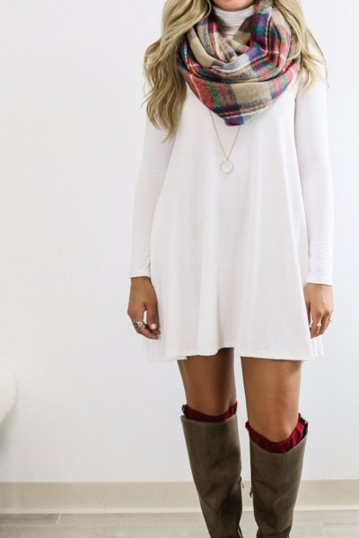 white long-sleeved swing dress with plaid crepe and navy scarf