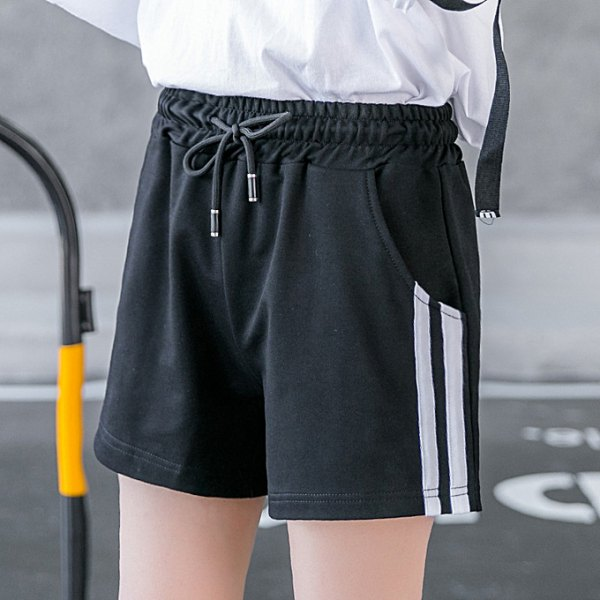 white long-sleeved t-shirt with black running shorts
