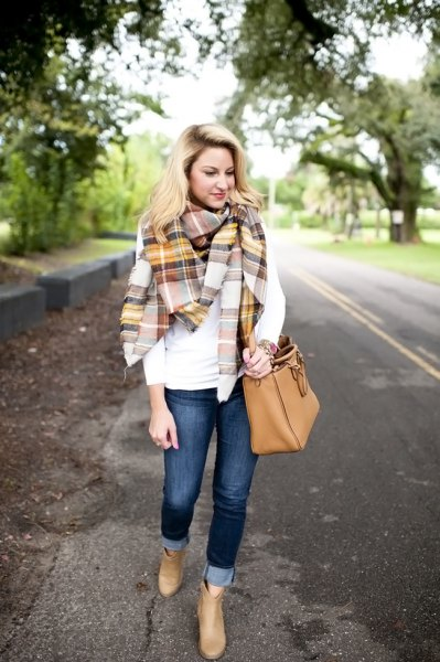 white long-sleeved T-shirt with gold and gray checked blanket scarf