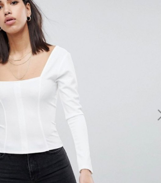 white long-sleeved top with black skinny jeans