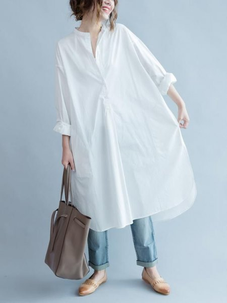 white long-sleeved tunic shirt with blue jeans and slippers