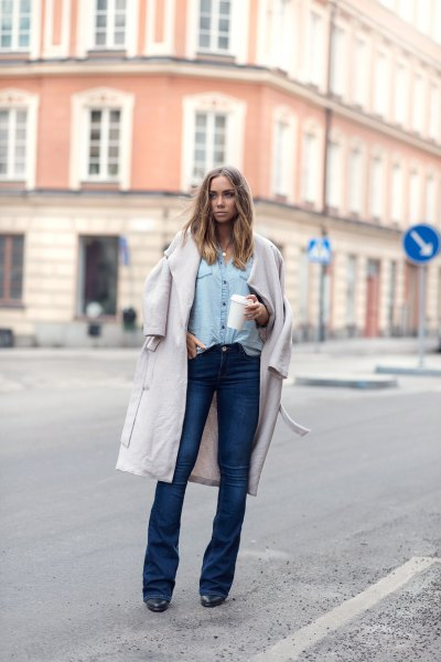 white long wool coat with light blue chambray shirt and dark blue flare jeans
