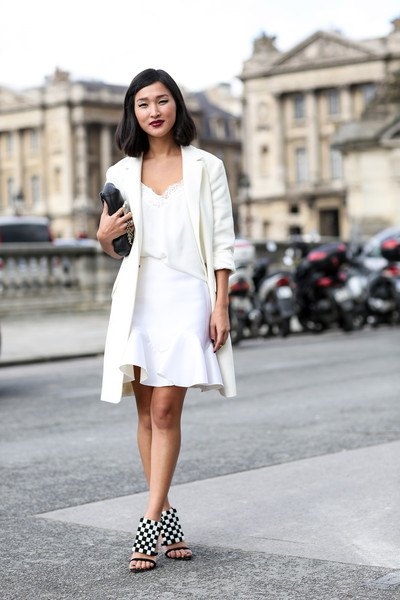white longline blazer with a mini skirt with a frilled hem and checked heels