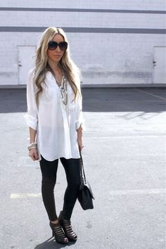 white longline shirt with buttons, black leggings and cut-out boots