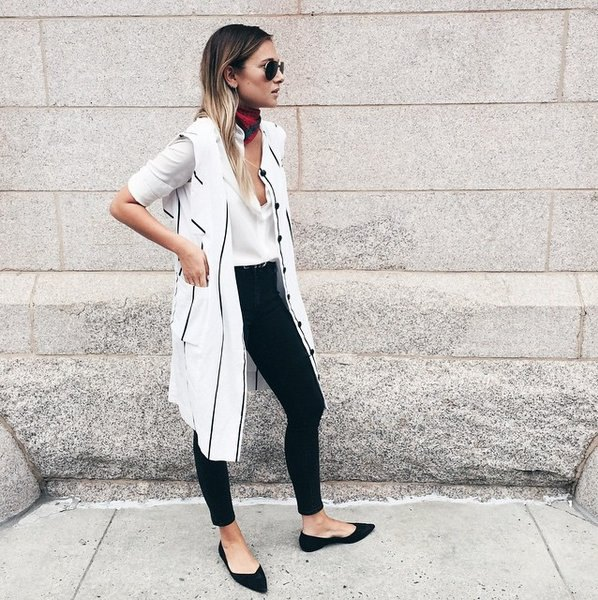white longline vest with a long blouse and black pointed flats