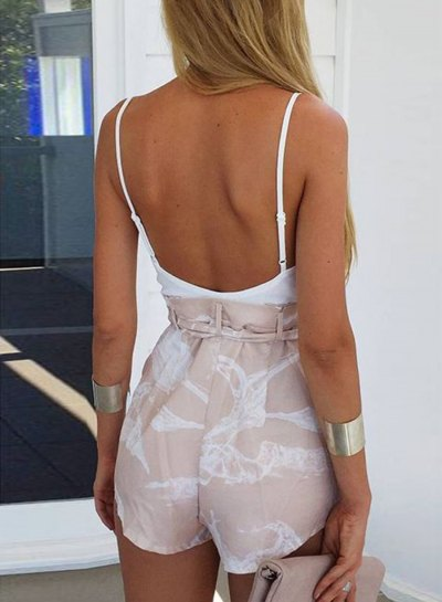 white tank top with scoop neck and low back and blushing pink mini shorts
