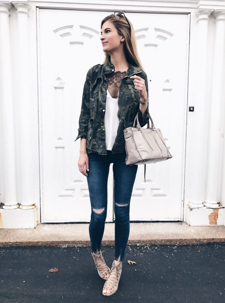 white tank top with deep scoop neckline, camouflage jacket and dark skinny jeans