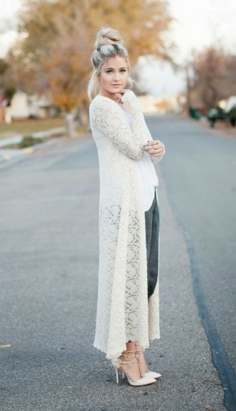 white maxi crochet sweater cardigan with black, cropped trousers