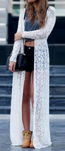 sheer transparent cardigan with white maxi flower pattern, gray crop top and black mini denim shorts
