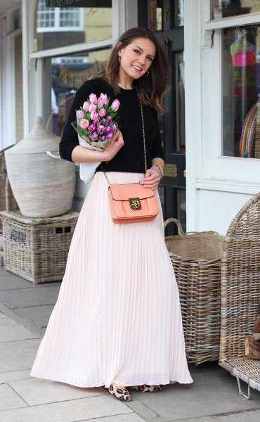 white maxi skirt with black knitted sweater with round neckline