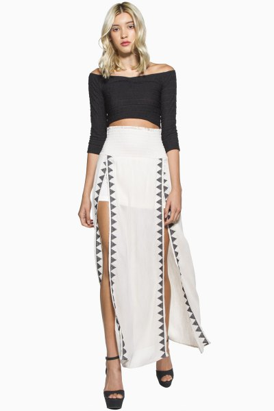 white maxi skirt with black three-quarter sleeves over the shoulder