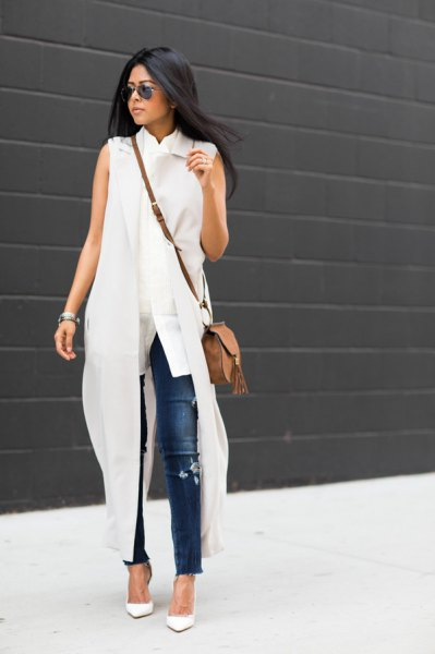 white sleeveless maxi dress with blue skinny jeans