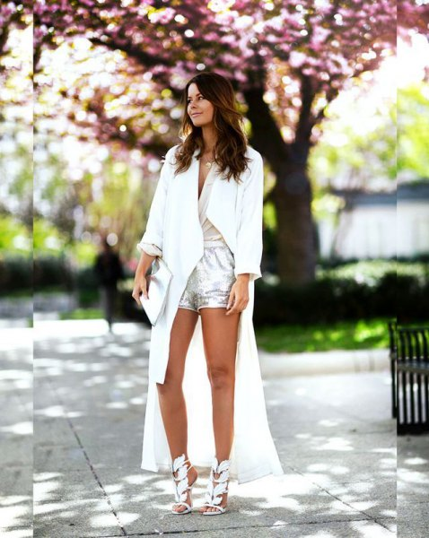 white maxi trench coat with silver shorts