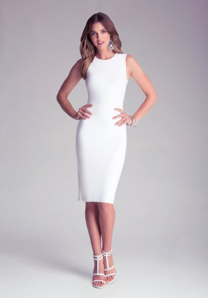 white, figure-hugging midi dress with open toe heels