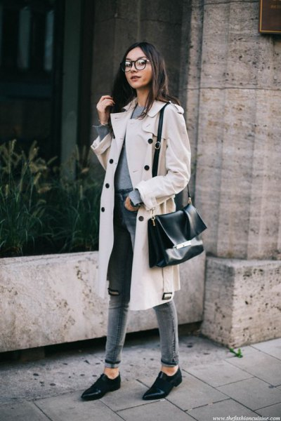 white midi winter trench coat with gray, high-waisted slim fit jeans with cuffs